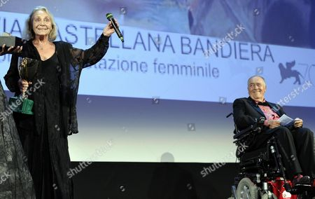 Italian Actress Elena Cotta (l) After Winning the Volpi Cup Award For Best Actress For the Movie 'Via Castellana Bandiera' As Italian Filmmaker Bernardo Bertolucci (r) the President of the Venezia 70 Jury Looks on During the Closing Award Ceremony of the 70th Venice International Film Festival in Venice Italy 07 September 2013 Italy Venice