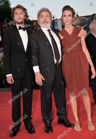 (l-r) Italian Actor/cast Member Gabriele Rendina Director Gianni Amelio and Actress Livia Rossi Arrive For the Premiere of 'L'inteprido' at the 70th Annual Venice International Film Festival in Venice Italy 04 September 2013 the Movie is Presented in the Official Competition Venezia 70 the Festival Runs From 28 August to 07 September Italy Venice
