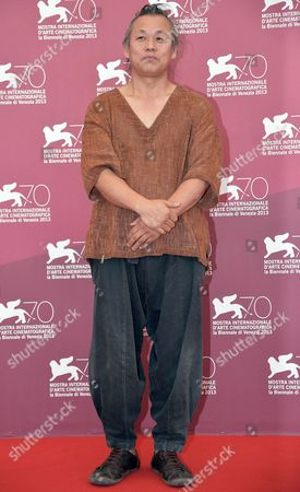 South Korean Director Kim Ki-duk Poses at a Photocall For 'Moebius' During the 70th Annual Venice International Film Festival in Venice Italy 03 September 2013 the Movie is Presented out of Competition at the Festival That Runs From 28 August to 07 September Italy Venice