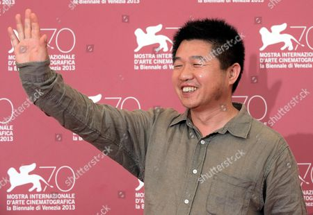 Chinese Movie Director Wang Bing Poses During a Photocall For 'Feng Ai' ('til Madness Do Us Part) at the 70th Annual Venice International Film Festival in Venice Italy 05 September 2013 the Movie is Presented out of Competition As Special Screening the Festival Runs From 28 August to 07 September Italy Venice