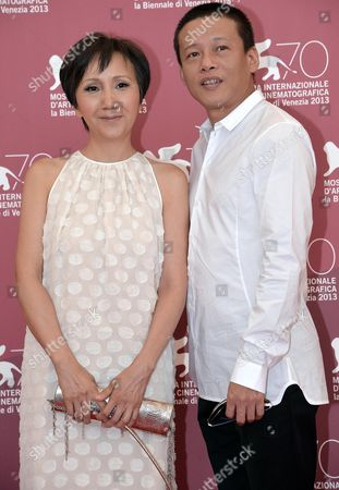 Taiwanese Actress/cast Members Lu Yi-ching (l) and Actor Lee Kang Sheng (r) Pose During a Photocall For 'Jiaoyou' (stray Dogs) at the 70th Annual Venice International Film Festival in Venice Italy 05 September 2013 the Movie is Presented in the Official Competition Venezia 70 the Festival Runs From 28 August to 07 September Italy Venice