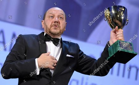 Greek Actor Themis Panou Holds the Volpi Cup After Receiving the Award For Best Actor For the Movie ''miss Violence'' During the Closing Award Ceremony of the 70th Venice International Film Festival in Venice Italy 07 September 2013 Italy Venice
