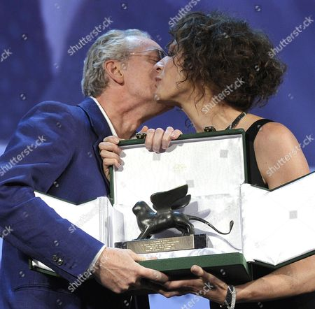 Italian Director Uberto Pasolini (l) Receives the Orizzonti Award For the Best Director From Member of the Orizzonti Jury Russian Actress Kseniya Rappoport For the Movie 'Still Life' During the Closing Award Ceremony of the 70th Venice International Film Festival in Venice Italy 07 September 2013 Italy Venice