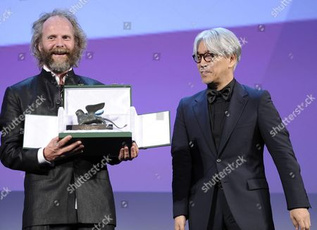 German Director Philip Groning (l) Receives the Special Jury Award From Member of the Venezia 70 Jury Japanese Musician Composer and Actor Ryuichi Sakamoto (r) For the Movie 'Die Frau Des Polizisten (the Police Officer's Wife)' During the Closing Award Ceremony of the 70th Venice International Film Festival in Venice Italy 07 September 2013 Italy Venice