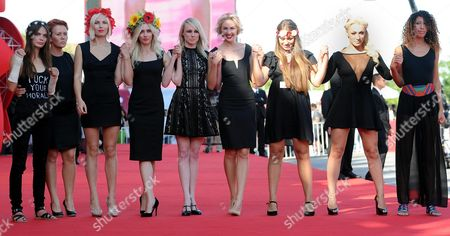 Australian Director Kitty Green (c) Arrives with Activists of the Feminist Protest Group Femen Including Inna Shevchenko (2-r) and Sasha Shevchenko (4-r) For the Screening of 'Ukraina Ne Bordel' (ukraine is not a Brothel) at the 70th Annual Venice International Film Festival in Venice Italy 05 September 2013 the Movie is Presented out of Competition As Special Screening the Festival Runs From 28 August to 07 September Italy Venice