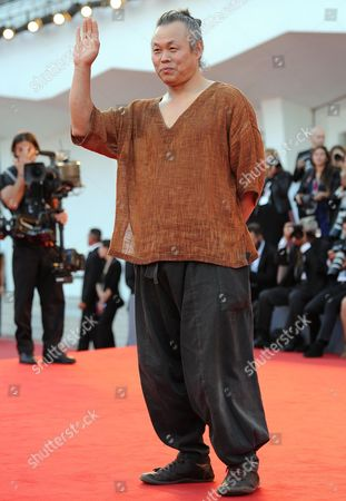 South Korean Film Director Kim Ki-duk Arrives on the Red Carpet to Promote the Movie 'Moebius' at the 70th Annual Venice International Film Festival in Venice Italy 03 September 2013 the Festival Runs From 28 August to 07 September Italy Venice
