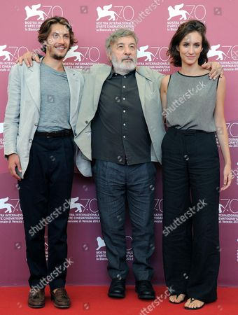Stock Image of Italian Director Gianni Amelio (c) Poses with Italian Actors Gabriele Rendina (l) and Livia Rossi at a Photocall For 'L'intrepido' During the 70th Annual Venice International Film Festival in Venice Italy 04 September 2013 the Movie is Presented Oin the Official Competition Venezia 70 of the Festival Running From 28 August to 07 September Italy Venice