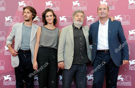 Stock Picture of (l-r) Italian Actors Gabriele Rendina and Livia Rossi Italian Director Gianni Amelio and Italian Actor Antonio Albanese Pose at a Photocall For 'L'intrepido' During the 70th Annual Venice International Film Festival in Venice Italy 04 September 2013 the Movie is Presented Oin the Official Competition Venezia 70 of the Festival Running From 28 August to 07 September Italy Venice