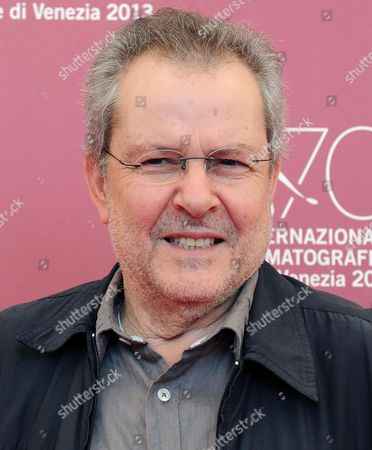Stock Image of Algerian Director Merzak Allouache Poses at a Photocall For 'Es-stouh' (the Rooftops) During the 70th Annual Venice International Film Festival in Venice Italy 06 September 2013 the Movie is Presented in the Official Competition Venezia 70 of the Festival Running From 28 August to 07 September Italy Venice