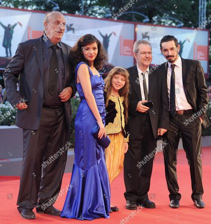 (l-r) Actors/cast Members Hacene Benzerari Meriem Medjkane Myriam Ait El Hadj Director Merzak Allouache and Nadjib Oulebsir Arrive For the Screening of 'Es-stouh' (les Terrasses / the Rooftops) at the 70th Annual Venice International Film Festival in Venice Italy 06 September 2013 the Movie is Presented in the Official Competition Venezia 70 the Festival Runs From 28 August to 07 September Italy Venice