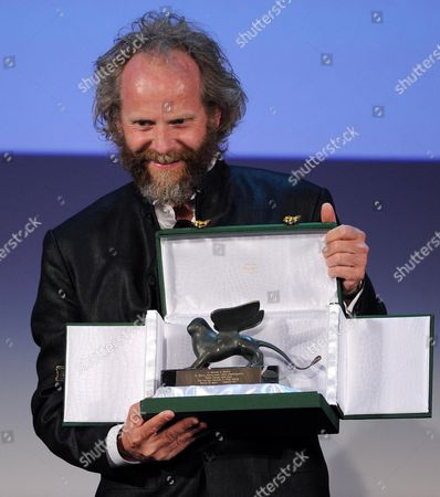 German Director Philip Groning Holds the Special Jury Award For the Movie 'Die Frau Des Polizisten (the Police Officer's Wife)' During the Closing Award Ceremony of the 70th Venice International Film Festival in Venice Italy 07 September 2013 Italy Venice
