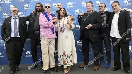 (l-r) Spanish Director Alex De La Iglesia Brasilian Director Hector Babenco Australian Director Warwick Thornton Mexican Director Guillermo Arriaga Indian Director Mira Nair Israeli Director Amos Gitai Iranian Director Bahman Ghobadi and Japanese Director Hideo Nakata Pose at a Photocall For 'Words with Gods' During the 71st Annual Venice International Film Festival in Venice Italy 30 August 2014 the Movie is Presented out of Competition at the Festival Running From 27 August to 06 September Italy Venice