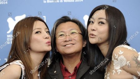 Stock Picture of (l-r) Chinese Actresses/cast Members Zhao Wei Director Peter Ho-sun Chan and Hao Lei Pose During a Photocall For the Movie 'Dearest' (qin'ai De) During the 71st Annual Venice Film Festival at the Lido in Venice Italy 28 August 2014 the Movie is Presented in the out of Competition Selection at the Festival Running From 27 August to 06 September Italy Venice
