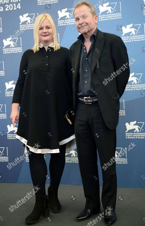 Austrian Writer-director Ulrich Seidl (r) and Austrian Sreenwriter Veronika Franz (l) Pose at a Photocall For 'Im Keller (in the Basement))' During the 71st Annual Venice International Film Festival in Venice Italy 29 August 2014 the Movie is Presented out of Competition at the Festival Running From 27 August to 06 September Italy Venice