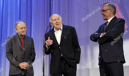 (l-r) Us Director Frederick Wiseman French Actor Michel Piccoli and Italian Festival Director Alberto Barbera Stand on the Stage During the Golden Lion For Lifetime Achievement Award Ceremony During the 71st Annual Venice Film Festival at the Lido in Venice Italy 29 August 2014 the Festival Runs From 27 August to 06 September Italy Venice