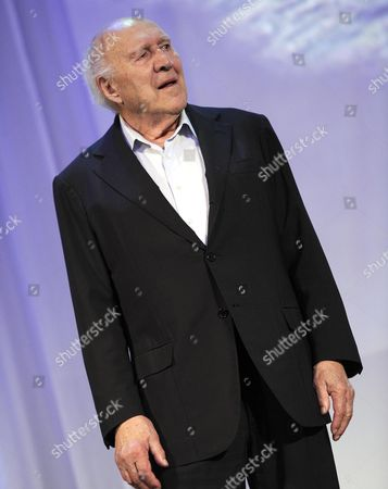 Stock Image of French Actor Michel Piccoli Stands on the Stage During the Golden Lion For Lifetime Achievement Award Ceremony During the 71st Annual Venice Lfilm Festival at the Lido in Venice Italy 29 August 2014 the Festival Runs From 27 August to 06 September Italy Venice