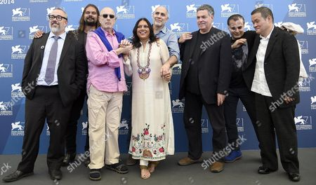 Stock Picture of (l-r) Spanish Director Alex De La Iglesia Brasilian Director Hector Babenco Australian Director Warwick Thornton Indian Director Mira Nair Mexican Director Guillermo Arriaga Israeli Director Amos Gitai Iranian Director Bahman Ghobadi and Japanese Director Hideo Nakata Pose at a Photocall For 'Words with Gods' During the 71st Annual Venice International Film Festival in Venice Italy 30 August 2014 the Movie is Presented out of Competition at the Festival Running From 27 August to 06 September Italy Venice