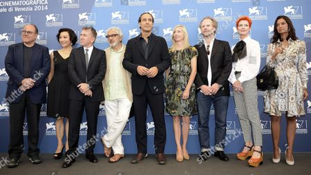 Members of the Venezia 71 Jury (l-r) Italian Actor-director Carlo Verdone Chinese Actress Joan Chen British Actor Tim Roth Palestinian Director Elia Suleiman French Composer and Jury President Alexandre Desplat Austrian Director Jessica Hausner German Filmmaker Philip Groening British Costume Designer Sandy Powell and Indian-us Writer Jhumpa Lahiri Pose at a Photocall For the 'Venezia 71 Jury' During the 71st Annual Venice International Film Festival in Venice Italy 27 August 2014 the Festival Runs From 27 August to 06 September Italy Venice