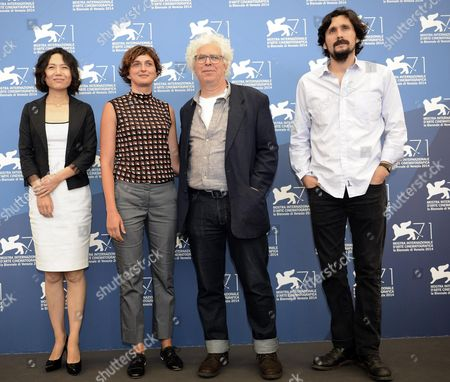 Members of the Opera Prima (debut Film) Jury (l-r) Chinese Director Vivian Qu Italian Director Alice Rohrwacher (president) Canadian Documentary Filmmaker Ron Man and Romanian Novelist and Screenwriter Razvan Radulescu Pose During a Photocall For the Opening Press Conference of the 71st Annual Venice International Film Festival in Venice Italy 27 August 2014 the Festival Runs From 27 August to 06 September Italy Venice