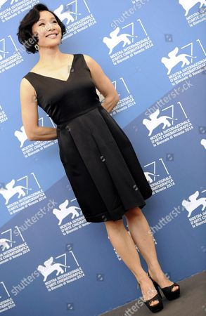 Chinese Actress and Jury Member Joan Chen Poses at a Photocall For the 'Venezia 71 Jury' During the 71st Annual Venice International Film Festival in Venice Italy 27 August 2014 the Festival Runs From 27 August to 06 September Italy Venice