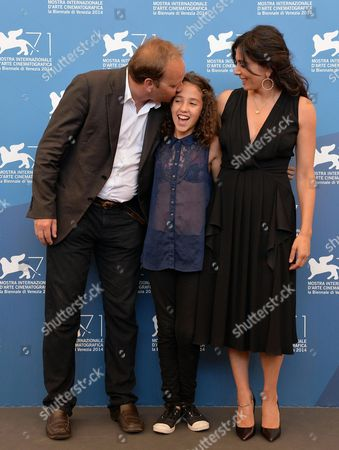French Director Xavier Beauvois (l) Actresses/cast Members Seli Gmach (c) and Nadine Labaki Pose at a Photocall For 'La Rancon De La Gloire' During the 71st Annual Venice International Film Festival in Venice Italy 28 August 2014 the Movie is Presented in the Official Competition Venezia 71 at the Festival That Runs From 27 August to 06 September Italy Venice