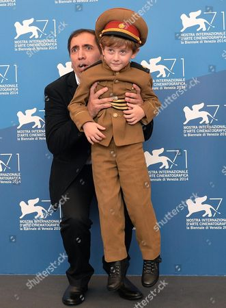 Iranian Director Mohsen Makhmalbaf (l) and Georgian Actor/cast Member Dachi Orvelashvili (r) Pose at a Photocall For 'The President' During the 71st Annual Venice International Film Festival in Venice Italy 27 August 2014 the Movie is Presented in the Orizzonti Section at the Festival That Runs From 27 August to 06 September Italy Venice