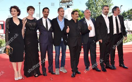 (l-r) Actors Anna Ferruzzo Barbora Bobulova Peppino Mazzotta Giuseppe Fumo Marco Leonardi Writer Gioacchino Criaco Italian Director Francesco Munzi and Actor Fabrizio Ferracane Arrive For the Premiere of 'Anime Nere' at the 71st Annual Venice Film Festival at the Lido in Venice Italy 29 August 2014 the Movie is Presented in the Official Competition at the Festival That Runs From 27 August to 06 September Italy Venice