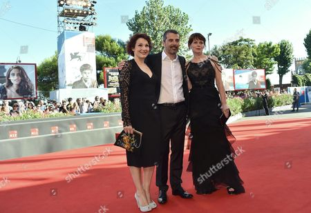 Italian Director Francesco Munzi (c) Arrives with Actresses Barbora Bobulova (r) and Anna Ferruzzo (l) For the Premiere of 'Anime Nere' at the 71st Annual Venice Film Festival at the Lido in Venice Italy 29 August 2014 the Movie is Presented in the Official Competition at the Festival That Runs From 27 August to 06 September Italy Venice