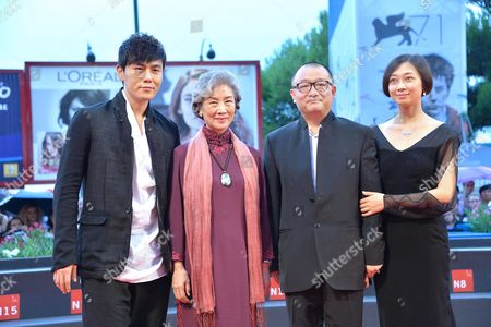 (l-r) Chinese Actors Qin Hao and Lu Zhong Director Wang Xiaoshuai and His Wife Arrive on the Red Carpet For the Premiere of 'Chuangru Zhe' (red Amnesia) During the 71st Annual Venice International Film Festival in Venice Italy 04 September 2014 the Movie is Presented in the Venezia 71 Section at the Festival That Runs From 27 August to 06 September 2014 Italy Venice