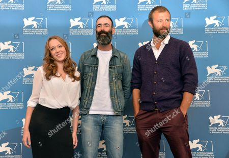 British Director Duane Hopkins (c) Poses with Actors/cast Members Charlotte Spencer (l) and Benjamin Dilloway (r) at a Photocall For 'Bypass' During the 71st Annual Venice International Film Festival in Venice Italy 02 September 2014 the Movie is Presented in the Orizzonti Section the Event is Scheduled to Run From 27 August to 06 September Italy Venice