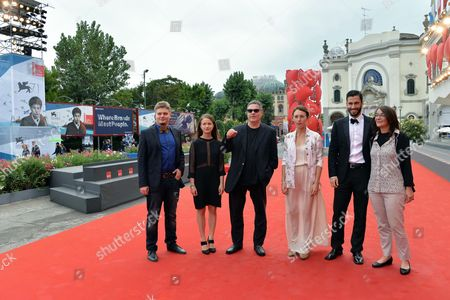 From (l-r): Composer Alexei Kochetkov Actress Meshi Olinski Israeli Director Amos Gitai Ukrainian Actress Sara Adler Actor Adam Tsekhman and Screenwriter Maria-jose Sanselme Pose on the Red Carpet For the Premiere of the Movie 'Tsili' During the 71st Annual Venice International Film Festival in Venice Italy 31 August 2014 the Movie is Presented out Competition at Venezia 71 Festival That Runs From 27 August to 06 September 2014 Italy Venice