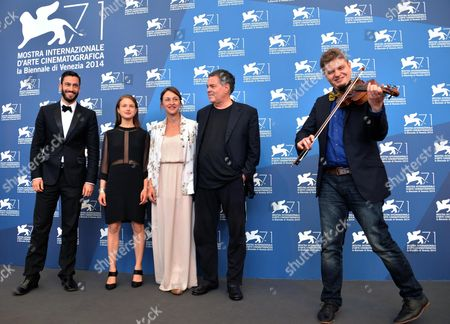 From (l-r): Actor Adam Tsekhman Actress Meshi Olinski Ukrainian Actress Sara Adler Israelian Director Amos Gitai and Composer Alexei Kochetkov Pose During a Photocall For the Movie 'Tsili' During the 71st Annual Venice International Film Festival at the Lido in Venice Italy 01 September 2014 the Movie is Presented in the Venezia 71 Section at the Festival Running From 27 August to 06 September Italy Venice