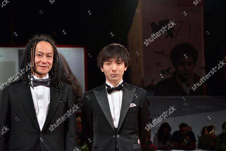 Stock Image of Japanese Actor Tatsuya Nakamura (l) and Yusako Mori (r) Arrive For the Premiere of 'Nobi' (fires on the Plain) During the 71st Annual Venice International Film Festival in Venice Italy 02 September 2014 the Movie is Presented in the Official Competition Venezia 71 of the Festival Running From 27 August to 06 September Italy Venice