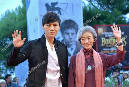 (l-r) Chinese Actor Qin Hao and Actress Lu Zhong Arrive on the Red Carpet For the Premiere of 'Chuangru Zhe' (red Amnesia) During the 71st Annual Venice International Film Festival in Venice Italy 04 September 2014 the Movie is Presented in the Venezia 71 Section at the Festival That Runs From 27 August to 06 September 2014 Italy Venice