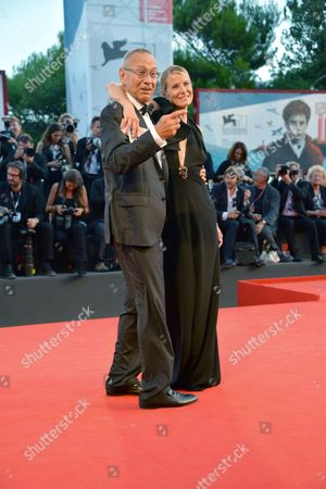 Russian Director Andrej Koncalovskij (l) and His Wife Julia Vysotskaya Arrive For the the Awarding Ceremony of the 71st Annual Venice International Film Festival in Venice Italy 06 September 2014 the Festival Runs From 27 August to 06 September Italy Venice