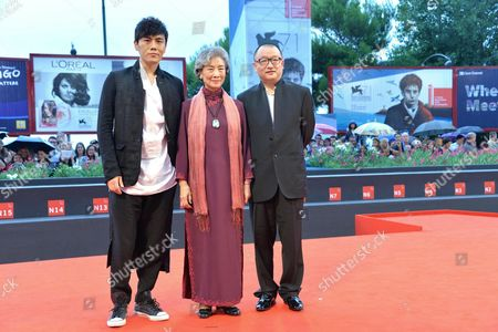 (l-r) Chinese Actor Qin Hao Director Wang Xiaoshuai and Actress Lu Zhong Arrive on the Red Carpet For the Premiere of 'Chuangru Zhe' (red Amnesia) During the 71st Annual Venice International Film Festival in Venice Italy 04 September 2014 the Movie is Presented in the Venezia 71 Section at the Festival That Runs From 27 August to 06 September 2014 Italy Venice