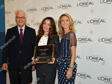 (l-r) Biennale President Paolo Baratta Italian Actress Valentina Corti and L'or?al Manager Stefania Fabiano Pose During a Photocall For 'L'or?al Paris Per Il Cinema Award' During the 71st Annual Venice International Film Festival Venice 05 September 2014 the Festival Runs From 27 August to 06 September 2014 Italy Venice