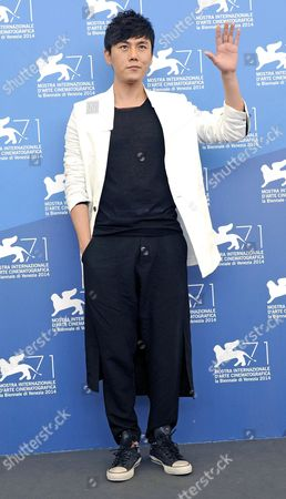 Chinese Actor/cast Member Qin Hao Poses During a Photocall For the Movie 'Chuangru Zhe' (red Amnesia) During the 71st Annual Venice International Film Festival in Venice Italy 04 September 2014 the Movie is Presented in the Venezia 71 Section at the Festival That Runs From 27 August to 06 September 2014 Italy Venice