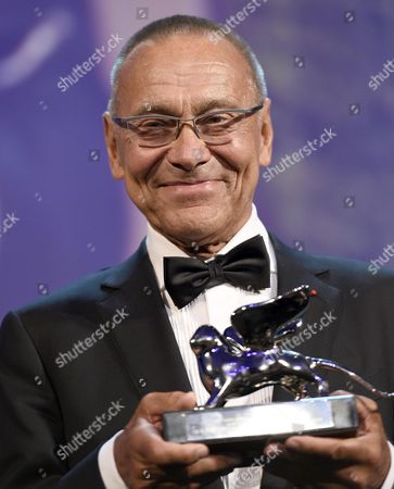 Russian Director Andrej Koncalovskij Holds the Silver Lion Award For Best Director For His Movie 'Belye Nochi Pochtalona Alekseya Tryapitsyna' (the Postman's White Nights)' During the Awarding Ceremony of the 71st Annual Venice International Film Festival in Venice Italy 06 September 2014 the Festival Runs From 27 August to 06 September Italy Venice
