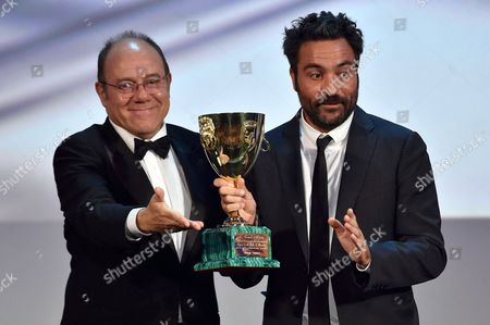 Stock Image of Italian Director Saverio Costanzo (r) Accepts the Volpi Cup Award For Best Actor on Behalf of Us Actor Adam Driver (not Pictured) For His Role in the Movie 'Hungry Hearts' From Italian Director and Venezia 71 Jury Member Carlo Verdone (l) During the Awarding Ceremony of the 71st Annual Venice International Film Festival in Venice Italy 06 September 2014 the Festival Runs From 27 August to 06 September Italy Venice