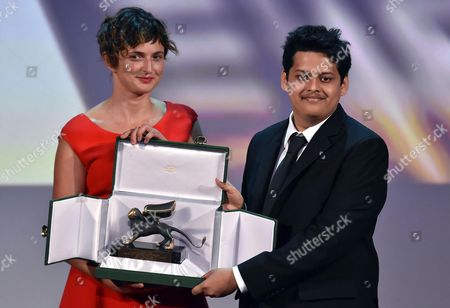 Indian Director Chaitanya Tamhane (r) Receives the Best Debut Film Award From Italian Director Alice Rohrwacher (l) the President of the Opera Prima (debut Film) Jury For His Movie 'Court' During the Awarding Ceremony of the 71st Annual Venice International Film Festival in Venice Italy 06 September 2014 the Festival Runs From 27 August to 06 September Italy Venice