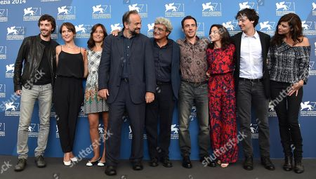 (l-r) Italian Actors Michele Riondino Isabella Ragonese an Unidentified Guest Italian Actor Massimo Popolizio Italian Director Mario Martone Italian Actors Elio Germano Federica De Cola Edoardo Natoli and French Actress Anna Mouglalis Pose During a Photocall For the Movie 'Il Giovane Favoloso' During the 71st Annual Venice International Film Festival at the Lido in Venice Italy 01 September 2014 the Movie is Presented in the Official Competition Venezia 71 at the Festival Running From 27 August to 06 September Italy Venice