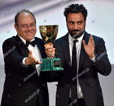 Italian Director Saverio Costanzo (r) Accepts the Volpi Cup Award For Best Actor on Behalf of Us Actor Adam Driver (not Pictured) For His Role in the Movie 'Hungry Hearts' From Italian Director and Venezia 71 Jury Member Carlo Verdone (l) During the Awarding Ceremony of the 71st Annual Venice International Film Festival in Venice Italy 06 September 2014 the Festival Runs From 27 August to 06 September Italy Venice