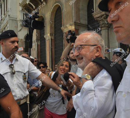 Former Venice's Mayor Giorgio Orsoni (2r) Leaves the Townhall in Venice Italy 13 June 2014 Giorgio Orsoni Resigned As Venice Mayor in the Mose Flood-barriers Graft Scandal Under Pressure From the Democratic Party (pd) That Backed Him Orsoni Plea-bargained a Release From House Arrest a Day Earlier Orsoni Had Been Held Since 04 June when Over 30 People Were Either Arrested Or Placed Under House Arrest in a Major Corruption Scandal Concerning Bribes From a Consortium Building a 5 5-billion-euro (7 5-billion-dollar) Dam System to Isolate Venice From High Tides Italy Venice