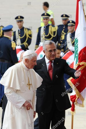 Pope Benedict Xvi Received by Lebanese President Michel Sleiman a Maronite Catholic at the International Rafiq Hariri in Beirut on 14 September 2012 Following His Arrival For a Three-day Visit to Lebanon During Which He Will Meet Civilian and Religious Leaders the Trip Comes Amid Worldwide Violent Anti-american Protests Caused by an American-produced Film Against the Prophet Mohammed Which the Pope Has Condemned Lebanon Beirut