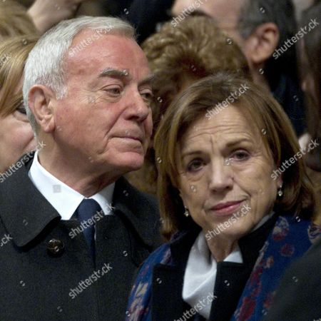 Stock Picture of Italian Ex Politician and Journalist Gianni Letta (l) and Italy's Minister of Labor Social Policies and Gender Equality Elsa Fornero (r) Reacts at the End of the Ashes Wednesday Mass Conducted by the Resigning Pope Benedict Xvi at Saint Peter Basilica Vatican City 13 February 2013 Pope Benedict Xvi Thanked the Public For Their Support and Prayers in His First Public Appearance Since Announcing His Resignation Benedict Said He Would Resign on 28 February Citing Advanced Age and the Strains of His Job in an Announcement That Stunned Catholics Worldwide It Will Be the First Papal Resignation in Almost 600 Years Vatican City State (holy See) Vatican City