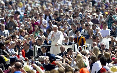 A Photo Taken 23 May 2012 of Pope Staff Member Paolo Gabriele (c-l) Sitting Next to the Driver of the 'Popemobile' (c-r) with Pope Benedict Xvi (c Standing) Being Driven on St Peter's Square Vatican Said 25 May That Its Police is Holding a Suspect in Connection with the 'Illegal' Possession of Classified Documents a Person was at the Disposal of the Vatican Magistrates For Ulterior Clarification Papal Spokesman Father Federico Lombardi was Quoted As Saying by the Ansa News Agency Lombardi's Announcement Came a Day After the Board of the Holy See's Bank the Institute For the Works of Religion (ior) Unanimously Voted to Dismiss Its President Ettore Gotti Tedeschi in a Decision Reportedly Linked to the Leaking of Vatican Documents the Identification of the Person who Lombardi Did not Name But Whom the Italian Daily Il Foglio Identified As a Pontiff's Domestic Staff Member Named Paolo Gabriele Follows an Investigation by the Vatican's Gendarmerie Corps Into the Leaking of Several Documents Including Confidential Letters Written to Pope Benedict Xvi Vatican City State (holy See) Vatican City