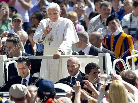 A Photo Taken 23 May 2012 of Pope Staff Member Paolo Gabriele (l Front) Sitting Next to the Driver of the 'Popemobile' with Pope Benedict Xvi Being Driven on St Peter's Square Vatican Said 25 May That Its Police is Holding a Suspect in Connection with the 'Illegal' Possession of Classified Documents a Person was at the Disposal of the Vatican Magistrates For Ulterior Clarification Papal Spokesman Father Federico Lombardi was Quoted As Saying by the Ansa News Agency Lombardi's Announcement Came a Day After the Board of the Holy See's Bank the Institute For the Works of Religion (ior) Unanimously Voted to Dismiss Its President Ettore Gotti Tedeschi in a Decision Reportedly Linked to the Leaking of Vatican Documents the Identification of the Person who Lombardi Did not Name But Whom the Italian Daily Il Foglio Identified As a Pontiff's Domestic Staff Member Named Paolo Gabriele Follows an Investigation by the Vatican's Gendarmerie Corps Into the Leaking of Several Documents Including Confidential Letters Written to Pope Benedict Xvi Vatican City State (holy See) Vatican City