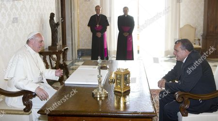 Pope Francis (l) and Honduras' President Porfirio Lobo Sosa (r) Sit For Talks As the Pontiff Receives His Guest and His Delegation in Private Audience at His Rooms at the Vatican Vatican City 20 September 2013 Man in Center is not Identified Vatican City State (holy See) Vatican City
