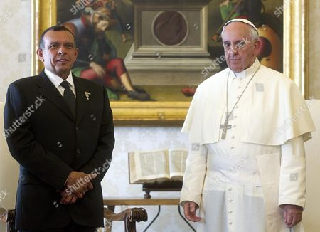 Pope Francis (r) and Honduras' President Porfirio Lobo Sosa (l) Pose For Photos As the Pontiff Receives His Guest and His Delegation in Private Audience at His Rooms at the Vatican Vatican City 20 September 2013 Man in Center is not Identified Vatican City State (holy See) Vatican City